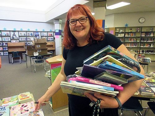Teacher Randi Null selecting books to have in her classroom for her students.