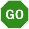 Stop sign - green octagon with GO written in white.