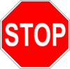 Stop sign - red octagon with STOP written in white.